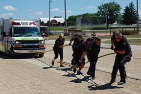 Paramedics, police officers, firefighters, and high school students battled it out to pull emergency service vehicles across the finish line before their competitors.
