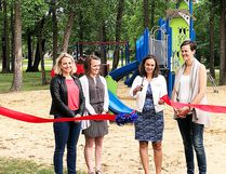 Members of the Koko Platz Rec Club (left to right) Carly Gabler, Jessica Martin, Jenna Bolton, Julene Toews-Dewis cut the ribbon to officially open the new park in Koko Platz. (supplied photo)