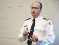 Aaron Floyd, Whitecourt deputy fire chief, presents during a community information night at École St. Joseph School on June 12 (Peter Shokeir | Whitecourt Star).