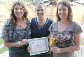 KASSIDY CHRISTENSEN HIGH RIVER TIMES/POSTMEDIA NETWORK. Photographed from left to right are third place winners Estrogen Express team members Lea Sorkilmo, Brenda McCredie and Dawn Bleackley. Their fourth team member Carol Macleod was not present.