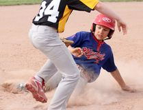 Mitchell's Ryan Klumper slides in safely at third base after tripling against Essex during the Jack Grasby Memorial Minor Mosquito Tournament last Friday, June 15 in Stratford. Mitchell won 11-9. CORY SMITH/POSTMEDIA NETWORK