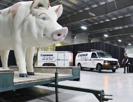 Tyler Wilson, right, spots Armor Pro Audio owner Bob Breen while he parks a trailer full of equipment inside the Rotary Complex for the Ontario Pork Congress on Monday, June 18, 2018 in Stratford, Ont. (Terry Bridge/Stratford Beacon Herald)