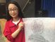 BCI student Jeriann Hsiao holds a rubbing of the headstone of Lieut. John Percy Orr, a BCI student who was killed in the First World War. (Vincent Ball/The Expositor)