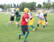 A Melfort Comets' quarterback goes back to pass and faces a relentless pass rush during an offense on defense drill at Melfort Comets' Spring Camp on Saturday, June 16.