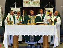 Bishop Ronald Fabbro (centre) celebrates a mass Sunday for all Catholic churches in Norfolk County held at Holy Trinity Catholic High School in Simcoe. SUSAN GAMBLE/Postmedia news