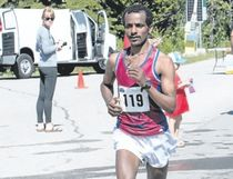 Banff resident Daniel Habteyes runs along the Bow Valley Parkway on his way to first place in the full Banff Marathon on Sunday.
