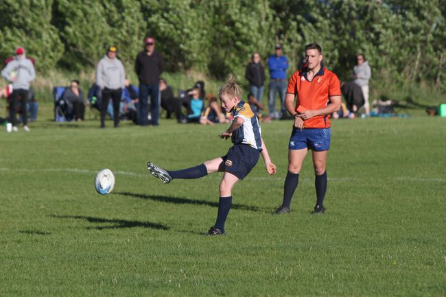 Caleb Graham goes for the extra point during a rugby game with his U13 Bow Valley Rugby (BVRC) Grizzlies team.