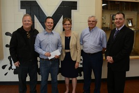 Mayor Peter Brown (from left to right), Jordan Harris, Margo Durocher, Martin Durocher, and Gary Bell pose for a photograph in the foyer of George McDougall High School. Harris was given a surprise $500 gift to use for the band program, from funds raised by the Mayors Leadership Prayer Breakfast.