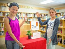 On May 30, an eleven-year-old author from Arborg visited her peers at Dr. George Johnson Middle School in Gimli to share her book about an imaginary young girl from a war-torn country whose education was disrupted by terrorists.Pictured: Grade 5 DGJMS students Ava and Vera stand next to Alliana's book displayed in the Gimli middle school's library on June 6.