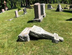 BRUCE BELL/THE INTELLIGENCER A monument lays on the ground in Picton's Glenwood Cemetery on Thursday morning. Vandals damaged approximately 200 headstones, monuments and urns on the 62-acre property late Wednesday afternoon or early evening.