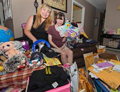 "Nicole Callander and her daughter, Kaitlin, show some of the cards and items sent to the girl for her 18th birthday on July 11. Callander has organized an ""unbirthday birthday party"" for Kaitlin and about 200 other kids next month in Mohawk Park. (Brian Thompson/The Expositor)"