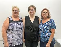 New secretary-treasurer Sandra Sharpe (left), MMF board chair Kerri Vandenberg (middle) and vice-chair Kim Chipman pose for a photo after being elected Thursday night. (Aaron Wilgosh)