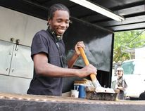 Kerano Buchanan brushes the Jack the Ribber grill prior to the start of Stratford Blues and Ribfest on Friday, June 22, 2018 in Stratford, Ont. (Terry Bridge/Stratford Beacon Herald)