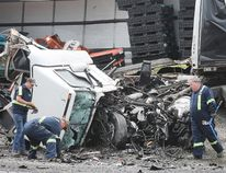 The wreckage of a collision between two tractor-trailers is shown on Friday, June 22, 2018 on Highway 401 near Tilbury, ON. One driver was killed and the other is in serious condition. The accident occurred just before 7:00 a.m. and shut down all lanes of the highway for several hours. (DAN JANISSE/THE WINDSOR STAR)