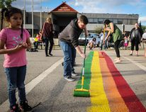 In honour of Pride Month, members and allies of the Maskwacis Two Spirit Society teamed up to paint a Pride flag in a crosswalk in front of Samson Cree Nation's band office in Maskwacis last Wednesday. (Sarah O. Swenson/Wetaskiwin Times)