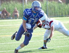 Gladiators running back Brad Patterson avoids a tackle during second-half action against the North Halton Crimson Tide last season. Keith Dempsey/For The Sudbury Star
