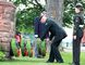Clyde Healey lays a wreath accompanied by Warrant Officer Cassandra Breckenridge, of 2310 Royal Canadian Army Cadets, as emcee Pierre Breckenridge watches during a Korean War memorial service at Sault Ste. Marie Canal National Historic Site on Friday.