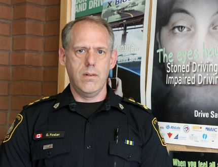 "Stratford police acting Chief Gerry Foster stands next to a poster at the police headquarters that reads ""Stone driving is impaired driving."" JONATHAN JUHA/THE BEACON HERALD/POSTMEDIA NETWORK"