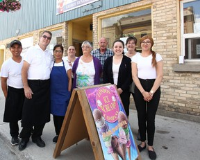 Family members connected to the Maria's Wok N Dine posed for a photo just after the grand opening last week. From left to right, Henry Lopez, John Staffen,Maria Staffen, Barb Stokes,Shirley Staffen, Dennis Duquette, Carol Duquette, Luanne Mc Gregor, Lian Hill.(Shaun Gregory/Huron Expositor)
