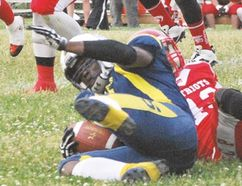Steelers' Alfonso Fuller goes down in tackle by Shaun Maye in Saturday's 45-0 loss to league leading Steel City Patriots of Hamilton. Allana Plaunt/Special to Sault This Week