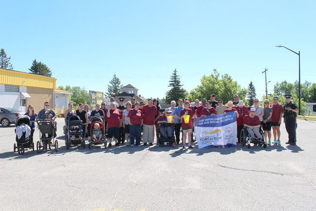Members of the community joined the Ontario Provincial Police, clients and staff of North East Association for Community Living (NEACL) for the annual Law Enforcement Torch Run.