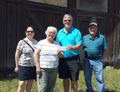 Ian Foster, centre, met with Carol and Ed Kurbis, Maureen Tyers and Sandra Beaudoin from the Hanna Roundhouse Society to make a donation on behalf of the 1967 Hanna Grad Class.