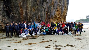 The cleanup crew team at Lepas Bay, Graham Island in Haida Gwaii, B.C. pose with some of the garbage they collected on May 22. (SUBMITTED PHOTO)