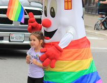 Blinky the Lighthouse, Kincardine's mascot was one of the many merrymakers dekked out in rainbow colours, alongside a parade-goer carrying a 'God Loves All People' sign.