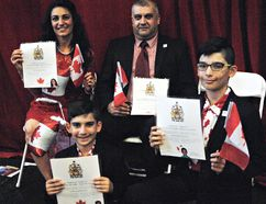 Laith Kachi and wife Rana Bihnam and their sons, Bashar, 11, and Rami, 7, became Canadian citizens at a special Canada Day citizenship ceremony held at the Boys and Girls Club. The ceremony was part of Brantford's Canada Day celebration. (Vincent Ball/The Expositor)