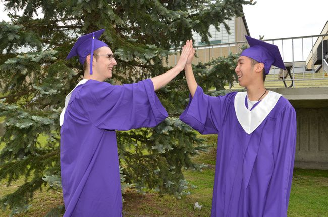 Friends Duncan MacDonald, left, and Yixi Ren both graduated from Lo-Ellen Park Secondary School on June 7. Yixi is the first student in the Rainbow International program to receive an Ontario Secondary School Diploma. (Photo supplied)
