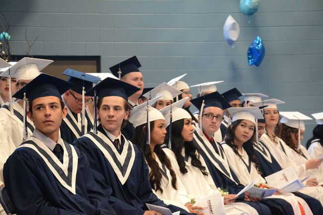 The Class of 2018 for École St. Joseph School waits to receive their high school diplomas on June 29. (Peter Shokeir | Whitecourt Star)