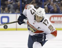 Florida Panthers center Derek MacKenzie chases the puck during the first period of an NHL hockey game against the Tampa Bay Lightning on Friday, Oct. 6, 2017, in Tampa, Fla. Chris O'Meara/Associated Press