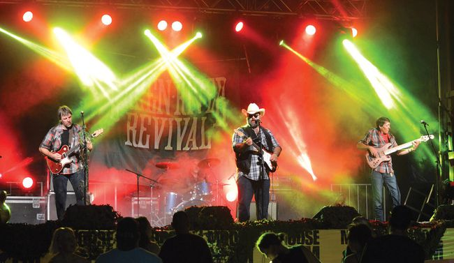 Photo by KEVIN McSHEFFREY/THE STANDARD Green River Revival, a Creedance Clearwater Revival tribute band, was the headliner at the Uranium Heritage Festival's Street Dance in Elliot Lake on Saturday night. It is estimated that more than 1,000 attended the street dance.