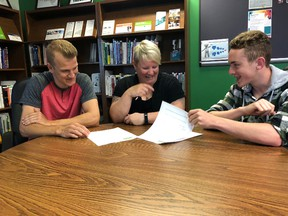 BRUCE BELL/THE INTELLIGENCER Jackson Cleave (left) and Quintin Lichty (right) get some instruction from Summer Company coordinator Liz Kryschuk at the Small Business Centre at Loyalist College on Thursday. The program aims to assist young entrepreneurs start their own company.