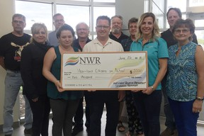 The Heartland Citizens on Patrol received $2,000 from Northwest Redwater Partnership on June 26. The funds will support volunteer's travel efforts while on patrol across the region.