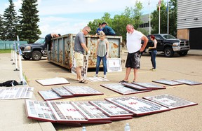 Former St. John Paul II Catholic School students spent part of their weekend diving into a dumpster to retrieve class and graduating photos that were thrown out.