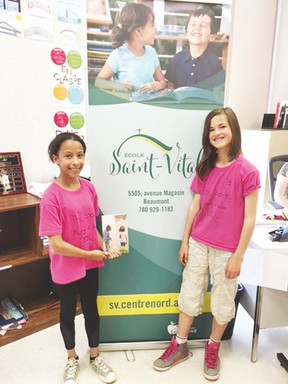 Livia Rainville (left) and Marie-Soleil Breton published their first novel, The Spooky Mystery at Sunset Camp, earlier in June. The two École Saint-Vital students are already working on their second novel. (Submitted)