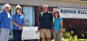 "Optimist Club of Ellice members pose beside the Township of Perth East's ""for sale"" sign in front of the Rostock Hall. As the Optimists' bid to purchase the hall was accepted earlier this week, that sign can soon be taken down. Pictured from left are treasurer Shirley Michiels, director Johanne Groenestege, club president Ivan Roobroeck, and Rostock Hall caretaker Ann Roobroeck. Galen Simmons/The Beacon Herald/Postmedia Network"