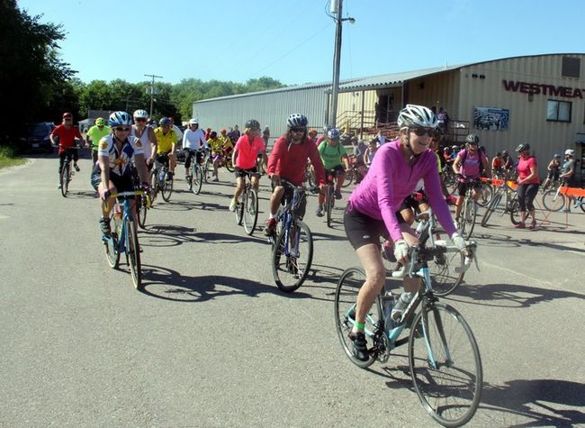 Sean Chase/Daily Observer The second annual Tour de Whitewater attracted 375 riders Saturday, including a bike club from Gatineau, Quebec. Here riders depart the Westmeath Recreation Centre Arena on the 50-kilometre course.