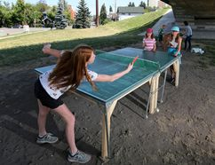 <p>Reilly McMillan, 12, plays ping pong with her sister Gracie, 9, and Joy McCullagh under the Fourth Avenue flyover on Wednesday August 9, 2017, in Calgary, Alta. </p><p> Gavin Young/Postmedia Network