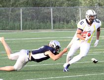 Sault Steelers receiver Todd Hicks is tackled by Sudbury Spartans defensive back Konnor Gillis during Northern Football Conference action at James Jerome Sports Complex in Sudbury Saturday.