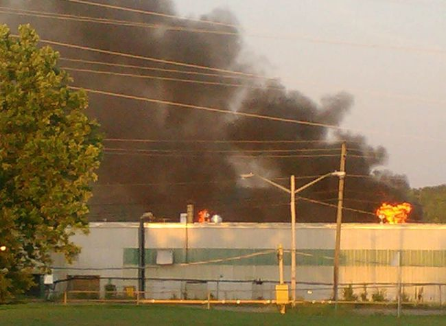 An Iroquois Falls resident submitted this photo showing flames and smoke coming from the warehouse located on the former Resolute Forest Product's papermill site late Saturday.