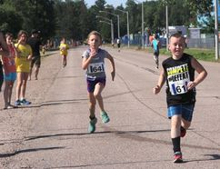 Sean Chase/Daily Observer A.J. Williams (right) is pursued by Jordyn Scantland-Proulx as they draw closer to finishing the Kids of Steel age 8-9 race at Garrison Petawawa.