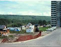 An Indigenous community of Métis and First Nation residents sits by the River Park Glen apartments sometime in the late 1970s or early 1980s in this file photo from the Northwest Territories Archives. Rene Fumoleau-Fonds/File Photo