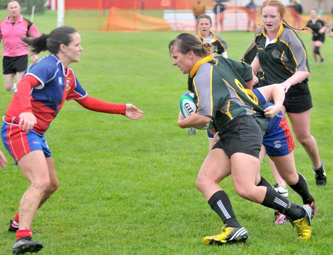Gordon Anderson/Daily Herald-Tribune Grande Prairie Sirens rugby player Annie Arsenault (right) prepares to meet a St. Albert Rugby Football Club player during Edmonton Rugby Union Women's Division II play at Macklin Field on Saturday afternoon. The Sirens dropped a 12-10 decision to the visitors.