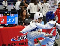 Six-year-old Preston Srinivasan (left), a member of the Sarnia Olympic Taekwondo Academy, delivers a roundhouse kick to his semi-final opponent at the Black Belt World Canadian Taekwondo Championship Festival tournament, which took place in Mississauga on June 24. Handout/Sarnia This Week