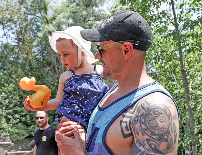 Luc Daviau and his daughter Lucy watch the annual KL Minor Hockey's Duck Race fundraiser.