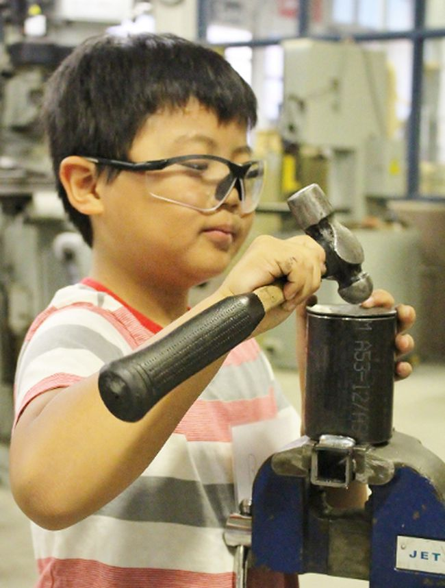 Brian Ahn, 10, works on his project during a welding session at Technical Training Group�s Step Camp at St. Michael Catholic Secondary School on Tuesday July 10, 2018 in Stratford, Ont. Terry Bridge/Stratford Beacon Herald/Postmedia Network