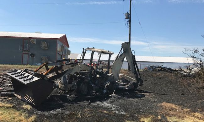A front-end loader and barn were destroyed in a grass fire west of Delhi Monday. Total damage is estimated at $300,000. Norfolk Fire & Rescue photo