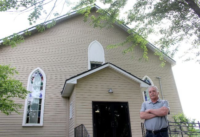 "Bryan Prince, a descendant of the original settlers of North Buxton, stands in front of the North Buxton Community Church that is being taken over by the British Methodist Episcopal Church of Canada. A letter writer says ""the British Methodist Episcopal Church's decision to evict North Buxton Community Church from that building is incomprehensible."" Ellwood Shreve/Postmedia Network"
